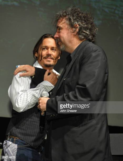 Actor Johnny Depp and director Tim Burton speak at Alice in Wonderland press conference during ComicCon 2009 held at San Diego Convention Center on...