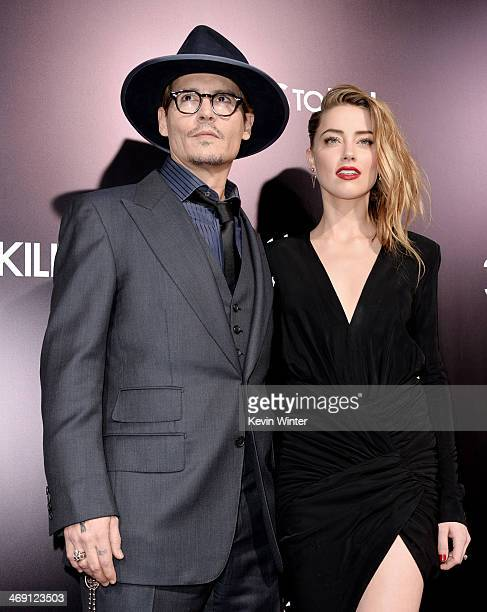 Actor Johnny Depp and his fiancee actress Amber Heard arrive at the premiere of Relativity Media's 3 Days To Kill at the Arclight Theatre on February...