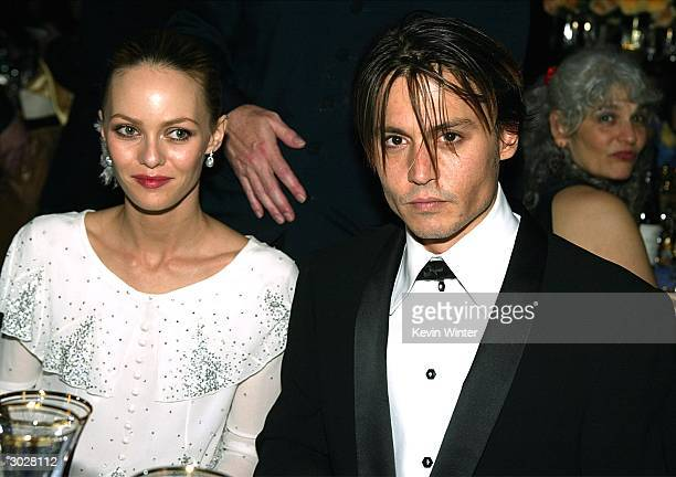 Actor Johnny Depp and his wife Vanessa Paradis pose at the The Governors Ball after the 76th Annual Academy Awards at the Renaissance Hollywood Hotel...