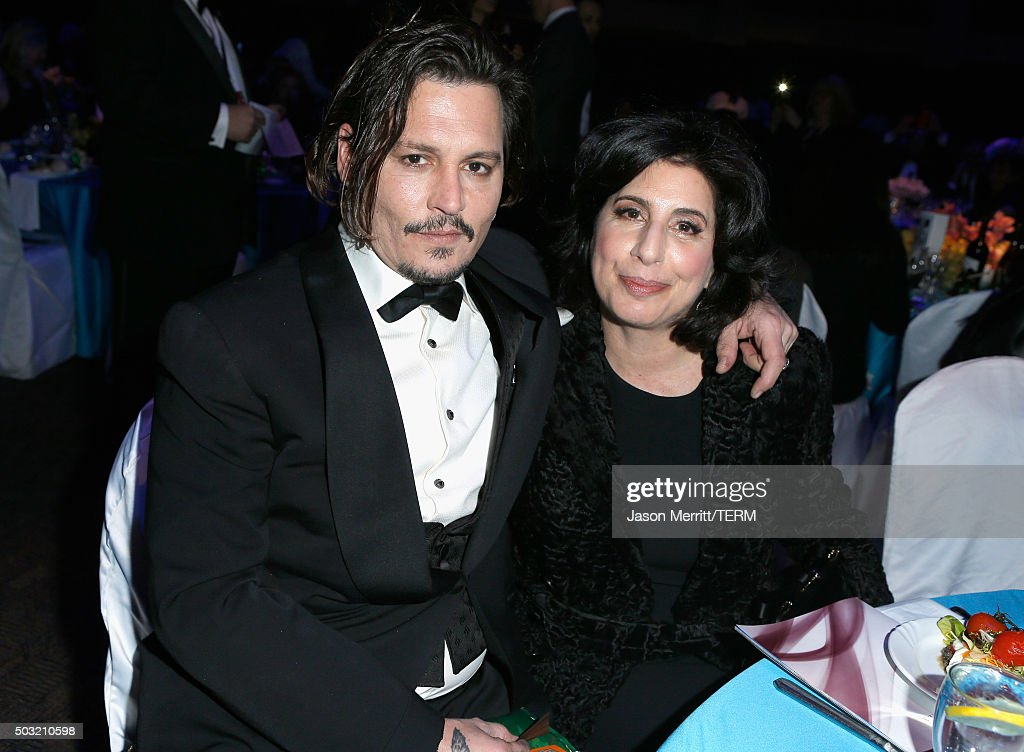 Actor Johnny Depp (L) and President, Worldwide Marketing and Distribution for Warner Bros. Sue Kroll attend the 27th Annual Palm Springs International Film Festival Awards Gala at Palm Springs Convention Center on January 2, 2016 in Palm Springs, California.