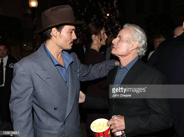 """Actor Johnny Depp and producer Richard D. Zanuck arrive at the special screening of DreamWorks Pictures' """"Sweeney Todd"""" at the Paramount Theater on..."""