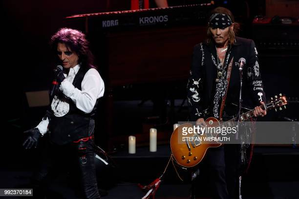US actor Johnny Depp and singer Alice Cooper perform with The Hollywood Vampires band during the 52th Montreux Jazz Festival on July 5 2018 in...
