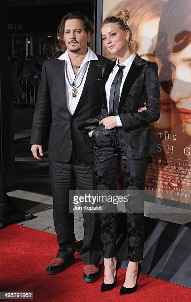 Actor Johnny Depp and wife actress Amber Heard arrive at the Los Angeles Premiere Of Focus Features' 'The Danish Girl' at Westwood Village Theatre on...
