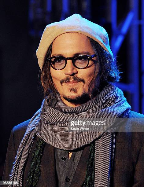 Actor Johnny Depp appears onstage at Walt Disney Pictures Buena Vista Records 'Alice in Wonderland' Fan Event at Hollywood Highland on February 19...
