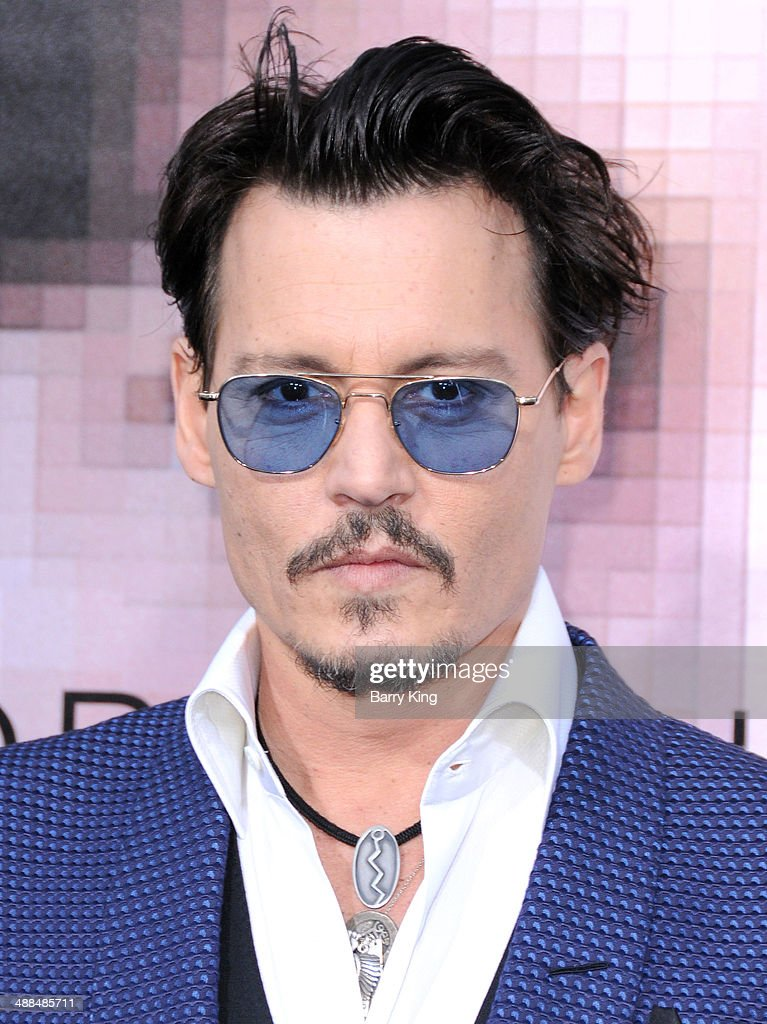 Actor Johnny Depp arrives at the Los Angeles premiere 'Transcendence' on April 10, 2014 at Regency Village Theatre in Westwood, California.