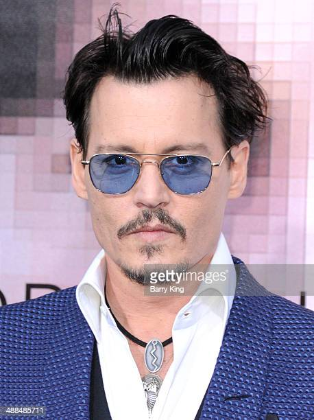 Actor Johnny Depp arrives at the Los Angeles premiere 'Transcendence' on April 10 2014 at Regency Village Theatre in Westwood California