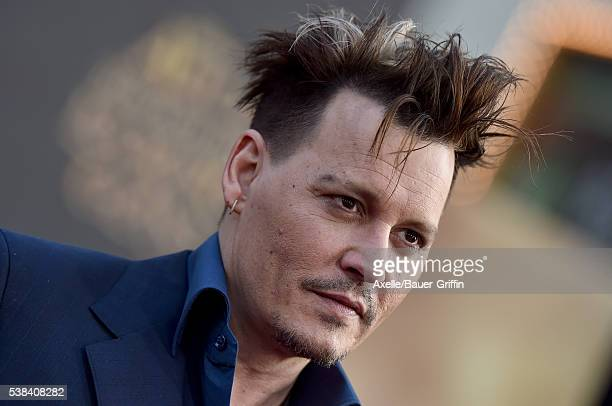 Actor Johnny Depp arrives at the premiere of Disney's 'Alice Through The Looking Glass' at the El Capitan Theatre on May 23 2016 in Hollywood...