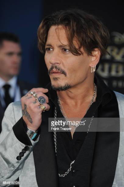 Actor Johnny Depp arrives at the premiere of Disney's Pirates of the Caribbean Dead Men Tell No Tales at the Dolby Theatre on May 18 2017 in...