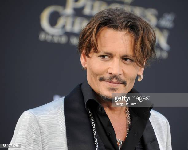 Actor Johnny Depp arrives at the premiere of Disney's Pirates Of The Caribbean Dead Men Tell No Tales at Dolby Theatre on May 18 2017 in Hollywood...