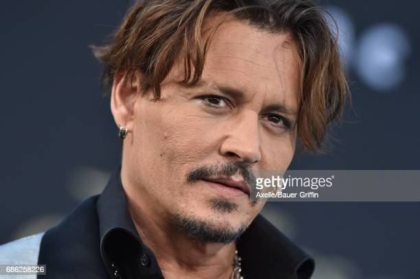 Actor Johnny Depp arrives at the premiere of Disney's 'Pirates of the Caribbean Dead Men Tell No Tales' at Dolby Theatre on May 18 2017 in Hollywood...
