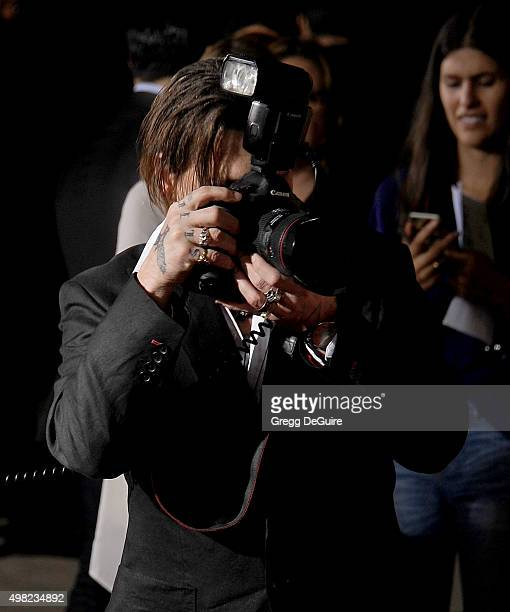 "Actor Johnny Depp arrives at the premiere of Focus Features' ""The Danish Girl"" at Westwood Village Theatre on November 21, 2015 in Westwood,..."