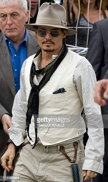 Actor Johnny Depp arrives before the 'Pirates of the Caribbean On Stranger Tides' photocall at the Palais des Festivals during the 64th Cannes Film...