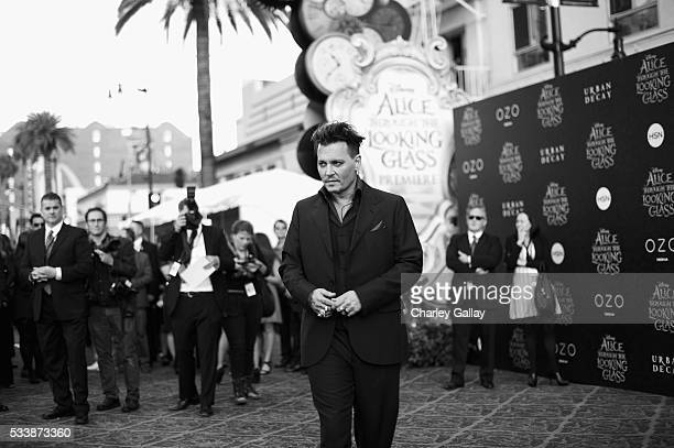 Actor Johnny Depp attends Disney's 'Alice Through the Looking Glass' premiere with the cast of the film which included Johnny Depp Anne Hathaway Mia...