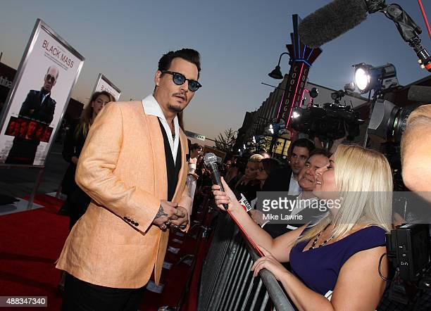 """Actor Johnny Depp attends the Boston premiere of """"Black Mass"""" at Coolidge Corner Theater on September 15, 2015 in Brookline, Massachusetts."""
