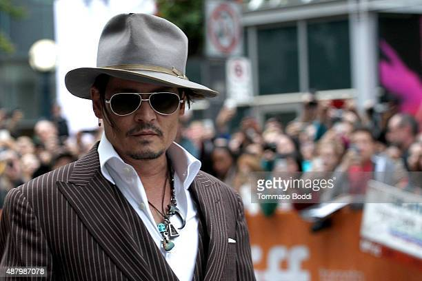 Actor Johnny Depp attends 'The Danish Girl' premiere during the 2015 Toronto International Film Festival held at the Princess of Wales Theatre on...