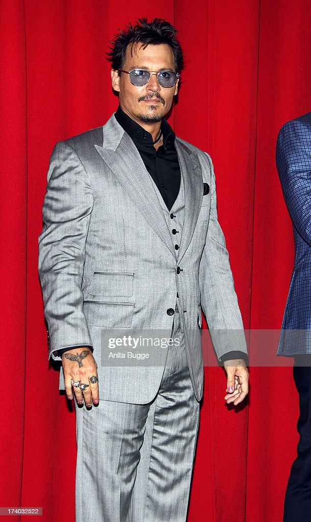 Actor Johnny Depp attends the ''Lone Ranger' Germany premiere at Sony Centre on July 19, 2013 in Berlin, Germany.