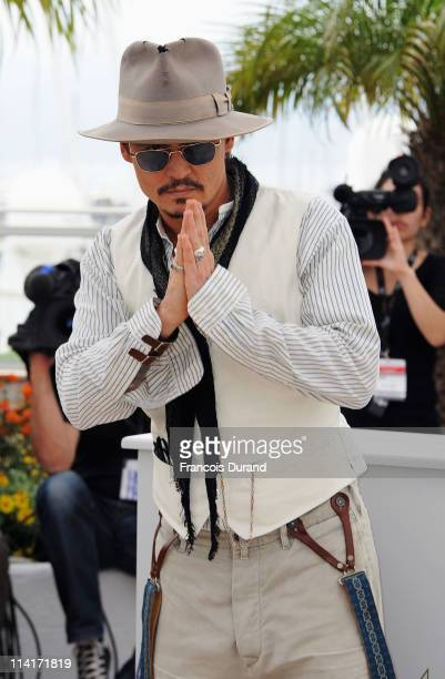 """Actor Johnny Depp attends the """"Pirates of the Caribbean: On Stranger Tides"""" photocall at the Palais des Festivals during the 64th Cannes Film..."""
