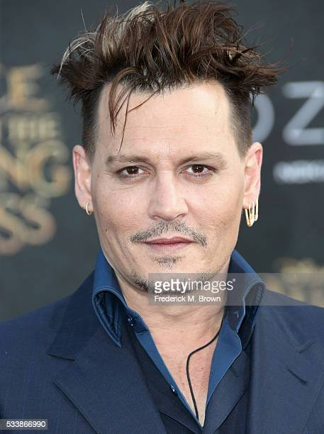 Actor Johnny Depp attends the premiere of Disney's 'Alice Through The Looking Glass at the El Capitan Theatre on May 23 2016 in Hollywood California