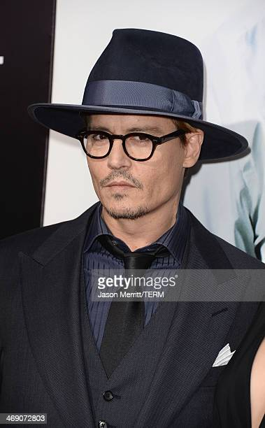 Actor Johnny Depp attends the premiere of Relativity Media's 3 Days To Kill at ArcLight Cinemas on February 12 2014 in Hollywood California