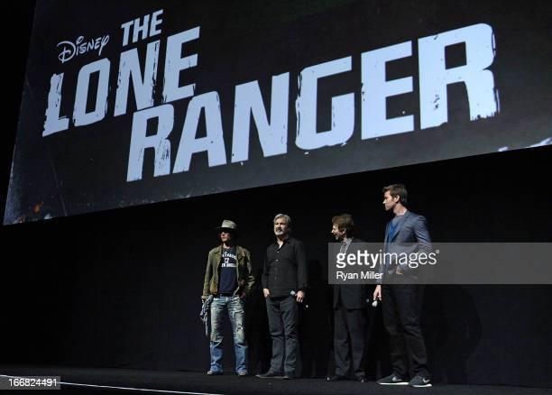 Actor Johnny Depp director and producer Gore Verbinski producer Jerry Bruckheimer and actor Armie Hammer speak onstage during The Walt Disney Studios...