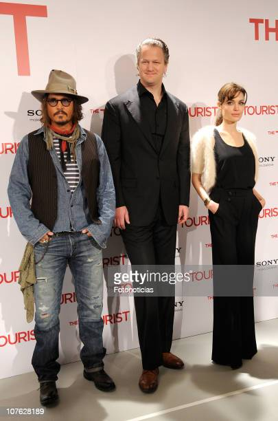 Actor Johnny Depp, director Florian Henckel Von Donnersmarck and actress Angelina Jolie attend 'The Tourist' photocall at the Villamagna Hotel on...