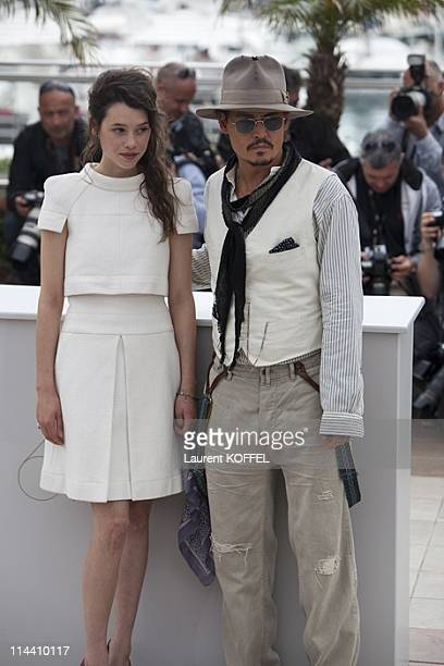 US actor Johnny Depp French actress AstridBerges Frisbey attend the 'Pirates of the Caribbean On Stranger Tides' Photocall during the 64th Annual...