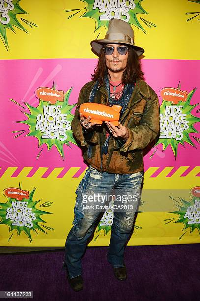 Actor Johnny Depp holds the Kids' Choice Award for Favorite Movie Actor backstage at Nickelodeon's 26th Annual Kids' Choice Awards at USC Galen...