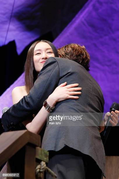 Actor Johnny Depp hugs Japanese actress Chiaki Kuriyama as they attend the Japan Premiere of 'Pirates Of The Caribbean Dead Men Tell No Tales' at the...