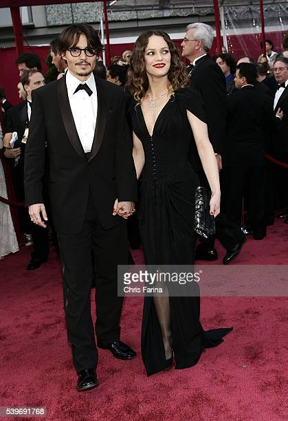 Actor Johnny Depp in a Giorgio Armani tuxedo and custom shirt by Anto Beverly Hills and Vanessa Paradis in Chanel Haute Couture gown and Chanel Fine...