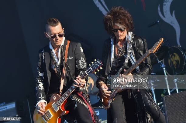 US actor Johnny Depp is flanked by US guitar player Joe Perry as they perform with The Hollywood Vampires band as part of the Hellfest metal music...