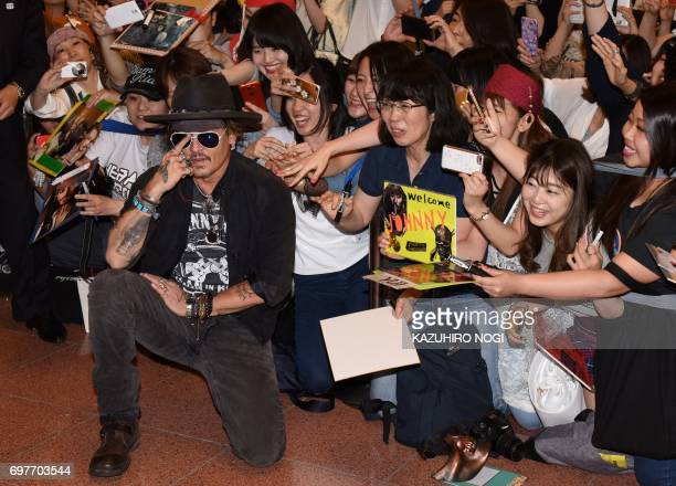 US actor Johnny Depp is greeted by Japanese fans upon his arrival to take part in promotional events for the Disney movie Pirates of the Caribbean...