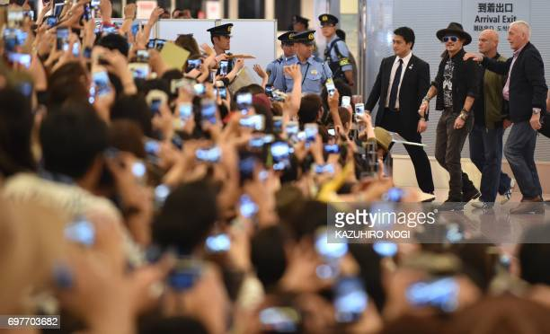 TOPSHOT US actor Johnny Depp is greeted by Japanese fans upon his arrival to take part in promotional events for the Disney movie 'Pirates of the...