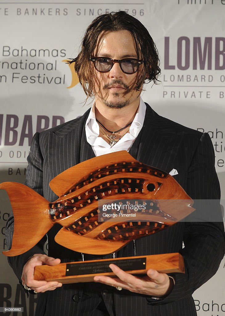 Actor Johnny Depp is honored with the prestigious Career Achievement Award at the 6th Annual Bahamas Film Festival special tribute and presentation at the Balmoral Club on December 13, 2009 in Nassau, Bahamas.