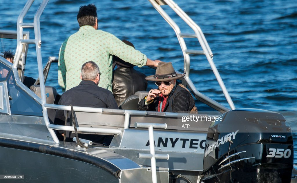 US actor Johnny Depp is pictured in a boat on his way to the concert with his band Hollywood Vampires at the Grona Lund amusement park in Stockholm, on May 30, 2016. Nyhetsbyrån / SUVAD MRKONJIC / United Kingdom OUT - Sweden OUT