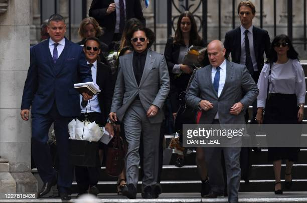 Actor Johnny Depp leaves the High Court after the final day of his libel trial against News Group Newspapers , in London, on July 28, 2020. - Johnny...