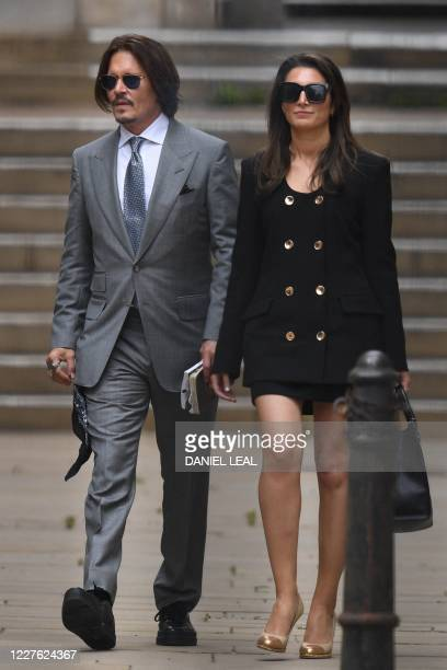 Actor Johnny Depp leaves with members of his team after day eight of his libel trial against News Group Newspapers at the High Court in London, on...