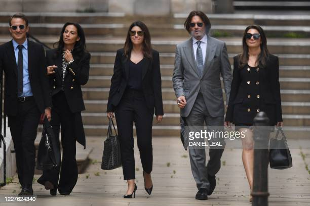 Actor Johnny Depp leaves with members of his team including lawyer Adam Waldman after day eight of his libel trial against News Group Newspapers at...