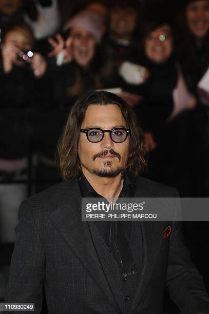 """Actor Johnny Depp looks on as he arrives for the premiere of his last film """"the Tourist"""" on December 16, 2010 at the Palacio de Deportes of Madrid...."""