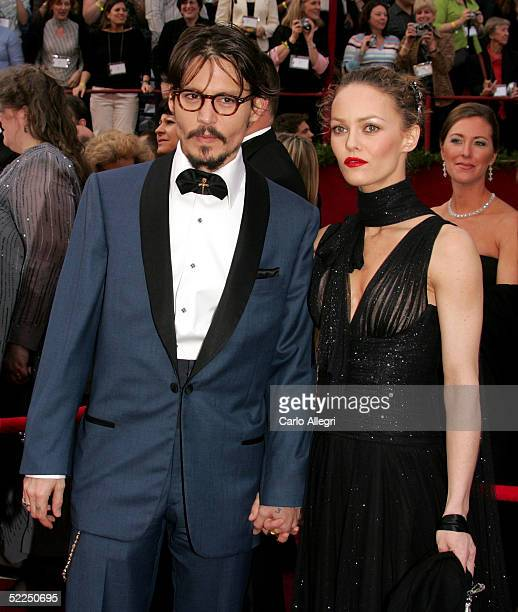 Actor Johnny Depp nominated for Best Actor in a Leading Role for his performance in 'Neverland' arrives with his girlfriend Vanessa Paradis at the...