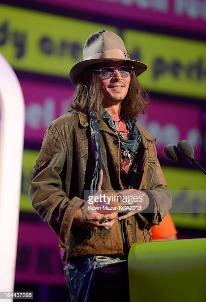 Actor Johnny Depp performs during Nickelodeon's 26th Annual Kids' Choice Awards at USC Galen Center on March 23 2013 in Los Angeles California