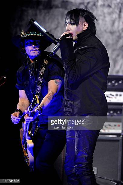 Actor Johnny Depp performs on stage with Marilyn Manson during the 2012 Revolver Golden Gods Award Show at Club Nokia on April 11 2012 in Los Angeles...