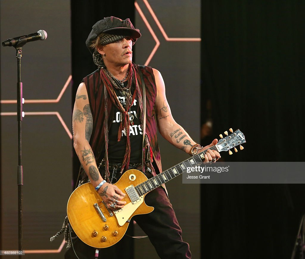 Actor Johnny Depp performs onstage at the TEC Awards during NAMM Show 2017 at the Anaheim Hilton on January 21, 2017 in Anaheim, California.