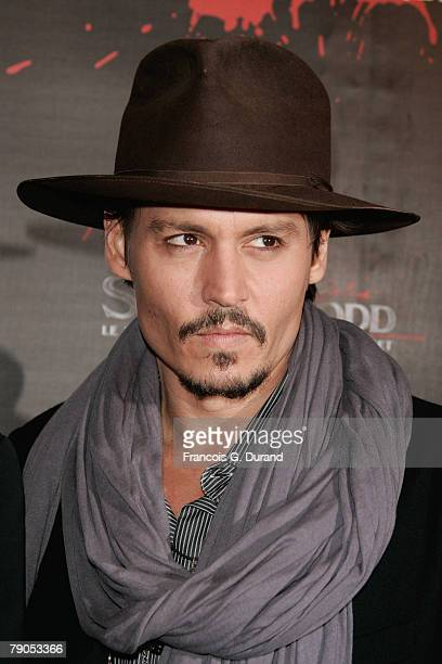 Actor Johnny Depp poses as he attends the 'Sweeney Todd' premiere on January 16 2008 in Paris France
