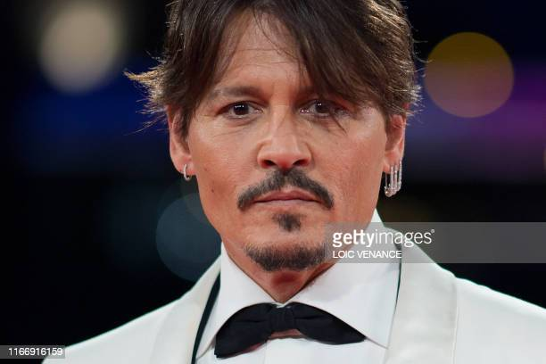 TOPSHOT US actor Johnny Depp poses as he leaves after a tribute ceremony during the 45th Deauville US Film Festival in Deauville northern France on...