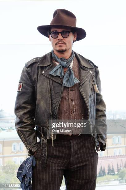 Actor Johnny Depp poses for a photocall before the Russian premiere of the film 'Pirates Of The Caribbean: On Stranger Tides' on the roof of the Ritz...