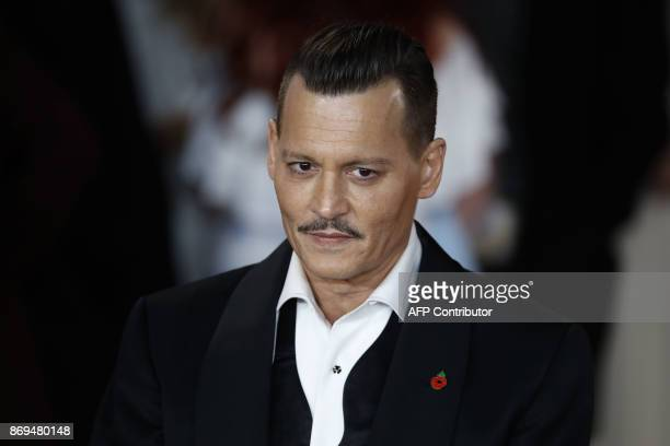 US actor Johnny Depp poses upon arrival to attend the world premiere of the film 'Murder on the Orient Express' at the Royal Albert Hall in west...