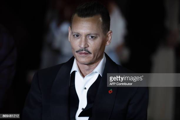 TOPSHOT US actor Johnny Depp poses upon arrival to attend the world premiere of the film 'Murder on the Orient Express' at the Royal Albert Hall in...