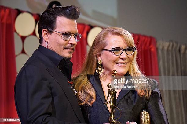 Actor Johnny Depp poses with award winner makeup artist Ve Neill at MakeUp Artists and Hair Stylists Guild Awards at Paramount Studios in California...