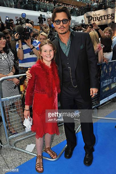 Actor Johnny Depp poses with School girl Beatrice Delap as he arrives for the UK Premiere of 'Pirates Of The Caribbean On Stranger Tides' at Vue...
