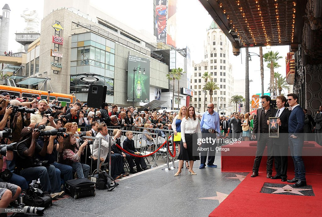Actor Johnny Depp, producer Jerry Bruckheimer and actor Tom Cruise attend Jerry Bruckheimer's Hollywood Walk of Fame ceremony on June 24, 2013 in Hollywood, California.